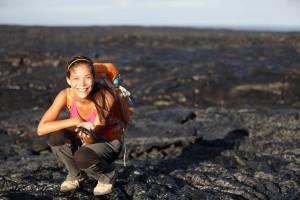 Hiker showing lava on Big Island, Hawaii