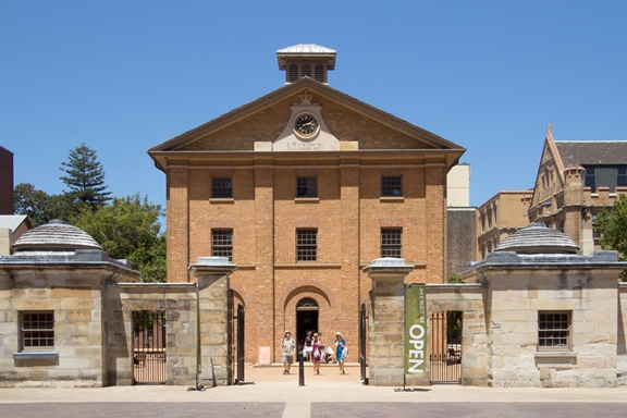 SYDNEY, AUSTRALIA-December 19th 2913: Tourists leaving the Hyde Park Barracks Museum. The building was built in 1819 originally to house convict men and boys.