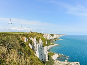 wind turbines on english channel shore in Normandy