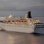 Cruise ship departing at dawn