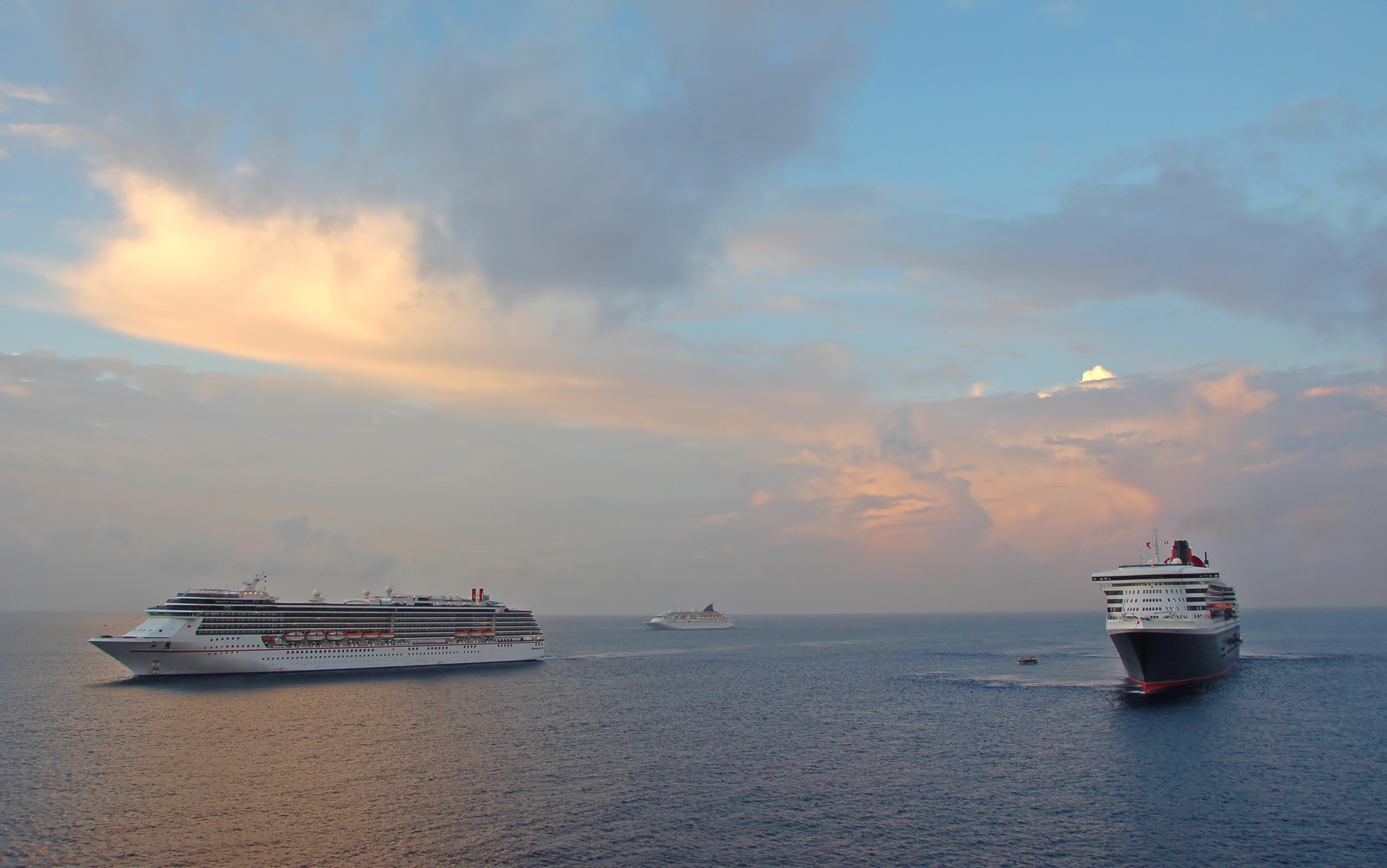 Panoramic view of three cruise ships at dawn